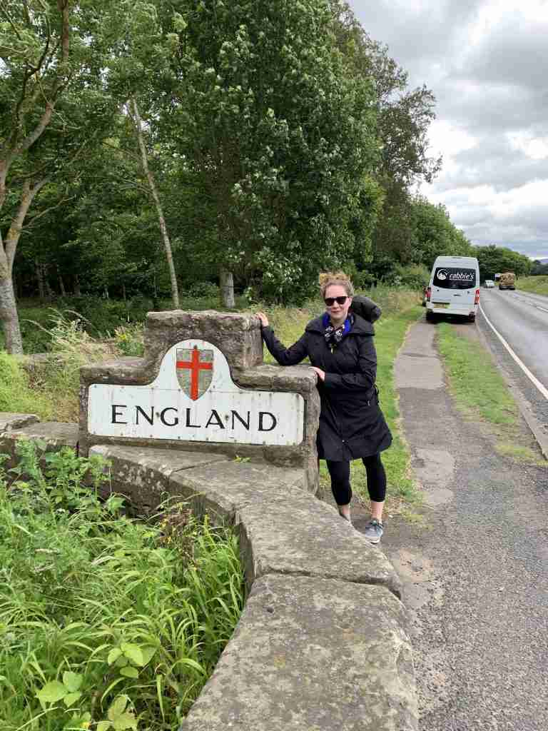 Solo female traveler on the Scotland-England border at Coldstream