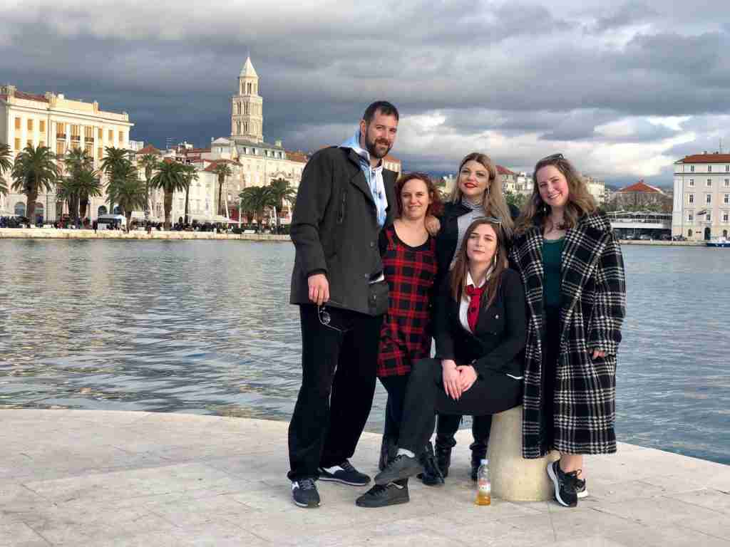 a group of digital nomads and local in Split, Croatia at Matejuska pier